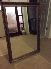 Ornate bevelled mirror