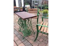 Cast iron singer table and two chairs with solid mahogany top