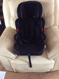 Car seat. Halfords Essentials 123. Brand new, unused. Suitable for children 9 months to 11 years