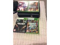 Xbox 360 with 4 games, theft auto 5