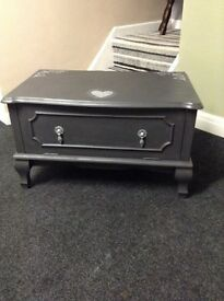 Solid wooden TV cabinet in grey with shabby chic heart detail