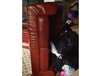 Leather look rust orange two seater sofa and chair
