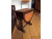 Antique coffee table wood leather wings