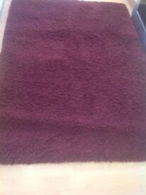 Large wine coloured rug