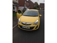 Yellow 1.2 corsa 1 previous owner lower milage black alloy wheels