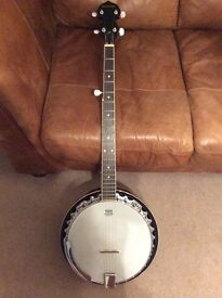 Barnes and Mullins 5 string banjo with lockable hard cover. Little used