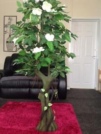 "5""3 artificial tree in good condition."