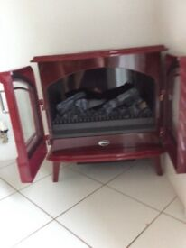 Dimples OPTIMYST Stove. Brand new. Rouge. Local store £625 Looks great. Unwanted surprise