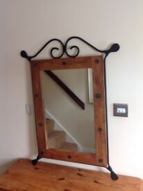 Ornate mirror framed with wrought ironwork