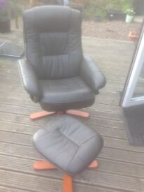Leather Swivel Chair and matching foot stool.