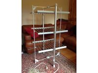 Electric clothes drying rail.