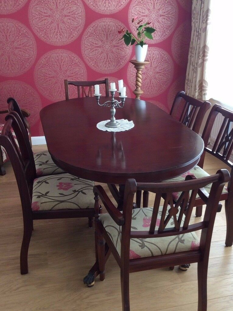Mahogany table and six chairs.