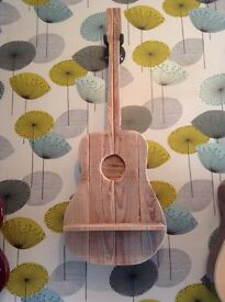 Guitar shaped shelf