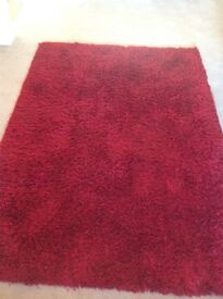 Large deep pile red rug