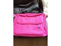 Pink laptop bag.