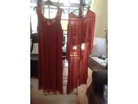 Rust coloured size 18 2 piece lovely dress and over jacket.