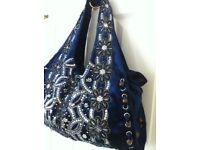 Blue velour slouch bag with bead and sequin design.