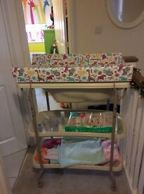 A baby bath and changing unit. In excellent condition.