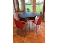 Bistro style kitchen table and 4 chairs.