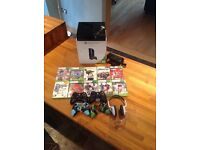Pre-owned Xbox 360 bundle - 250gb console, 10 games, 2 handsets + covers & headset