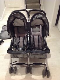 Combi Twin Cosmos Double Buggy with 2 matching padded foot muffs, rain cover and double bottle pouch