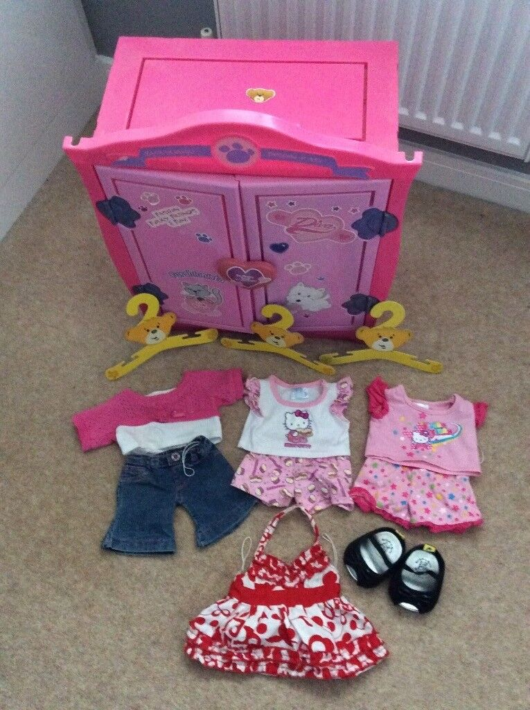 Build a bear wardrobe and 4 girl bear outfits with a pair of shoes