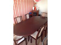 Rosewood Oval table and 6 chairs