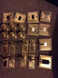 Brass antique effect door handles and light switches