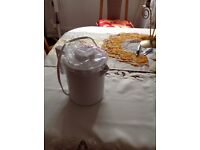 Travel kettle, three cups of water, brand new, never used.