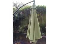 Green parasol 3 m lean over style with base
