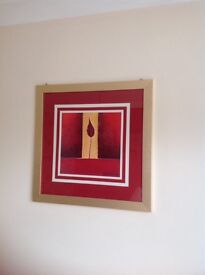 Large red picture in gold frame.