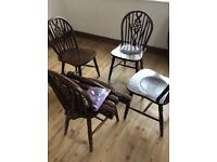 Dark wood round table and chairs.