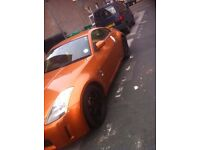 my orange 2003 Nissan 350Z for sale, serious buyers only