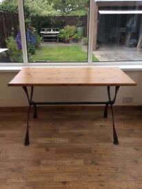 Pine table with curved iron legs