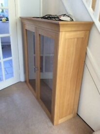 Beautiful display cabinet with glass shelves and internal lighting