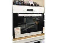 Beko white intergrated electric oven. £159 12 month Gtee