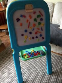 Children's easel with white board and chalk board and magnetic numbers and letters