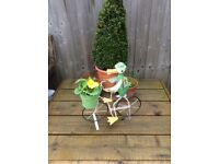 DUCK RIDING BIKE WITH FLOWERPOT . GREAT COLOURS AND FUN FOR YOUR GARDEN OR PATIO