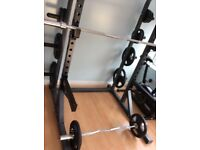 Barbell and EZ bar with plates