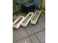 Three large painted stone planters