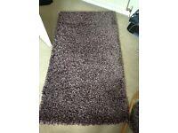 Dunelm purple slumber design rug.