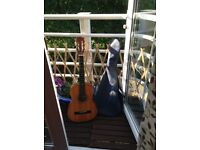 Guitar with blue fabric case. Good condition