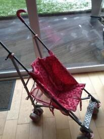 Mothercare pink stroller with rain cover