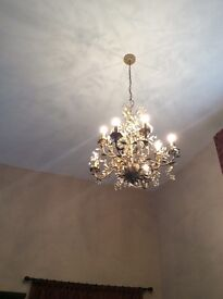 A pair of very large chandelier light fittings