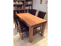 Modern oak dining table and 4 leather dining chairs