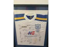Two signed and framed St. Johnstone football shirts.