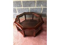 Mahogany coffee table with glass inset and matching bookcase in excellent condition