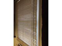 Three full length venetian window blinds