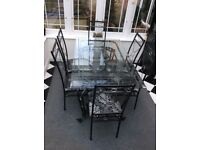 Wrought Iron Glass Top Table and 6 Chairs.