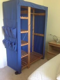 Blue canvas wardrobe with wooden frame